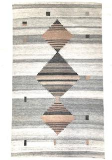 This grey tone background handwoven rug has some shades of grey along with three diamonds, two of them with a touch of mauve.