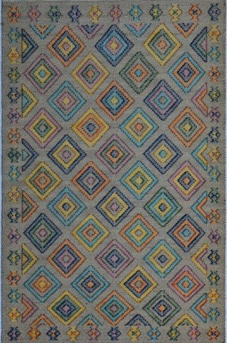 Handwoven wool rugs in several sizes with pastel diamond three dimentional design.