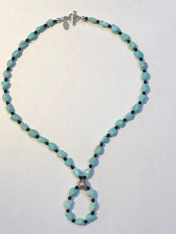 Genuine Campitos Turquoise with black agate and sterling silver Buddha center bead and clasp.  By A.S.  15""