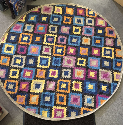 a 6 foot round rug in geometrics with lots of color