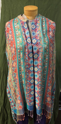 Pastel color woven fabric from Kashmir made into a cape.