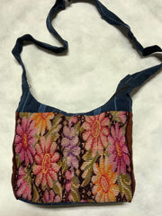 "Guatemalan handcrafted needlepoint purses with zipper and exterior zippered pocket.  Approximately 12"" x 8"", fully lined."