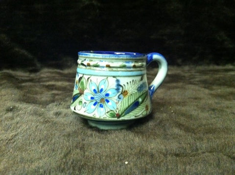 Ken Edwards Pottery Collection series coffee mug with bule rim.