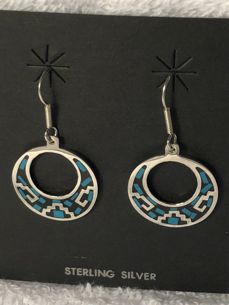 Aztec design sterling silver earrings with turquoise color inlay earrings.