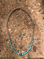 "Genuine Natural Kingman Turquoise beads with sterling silver beads and clasp.  17"" by A.S."