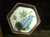 Ken Edwards Pottery Hexagon tray with brown rim and green, blue and white plants and wildlife.