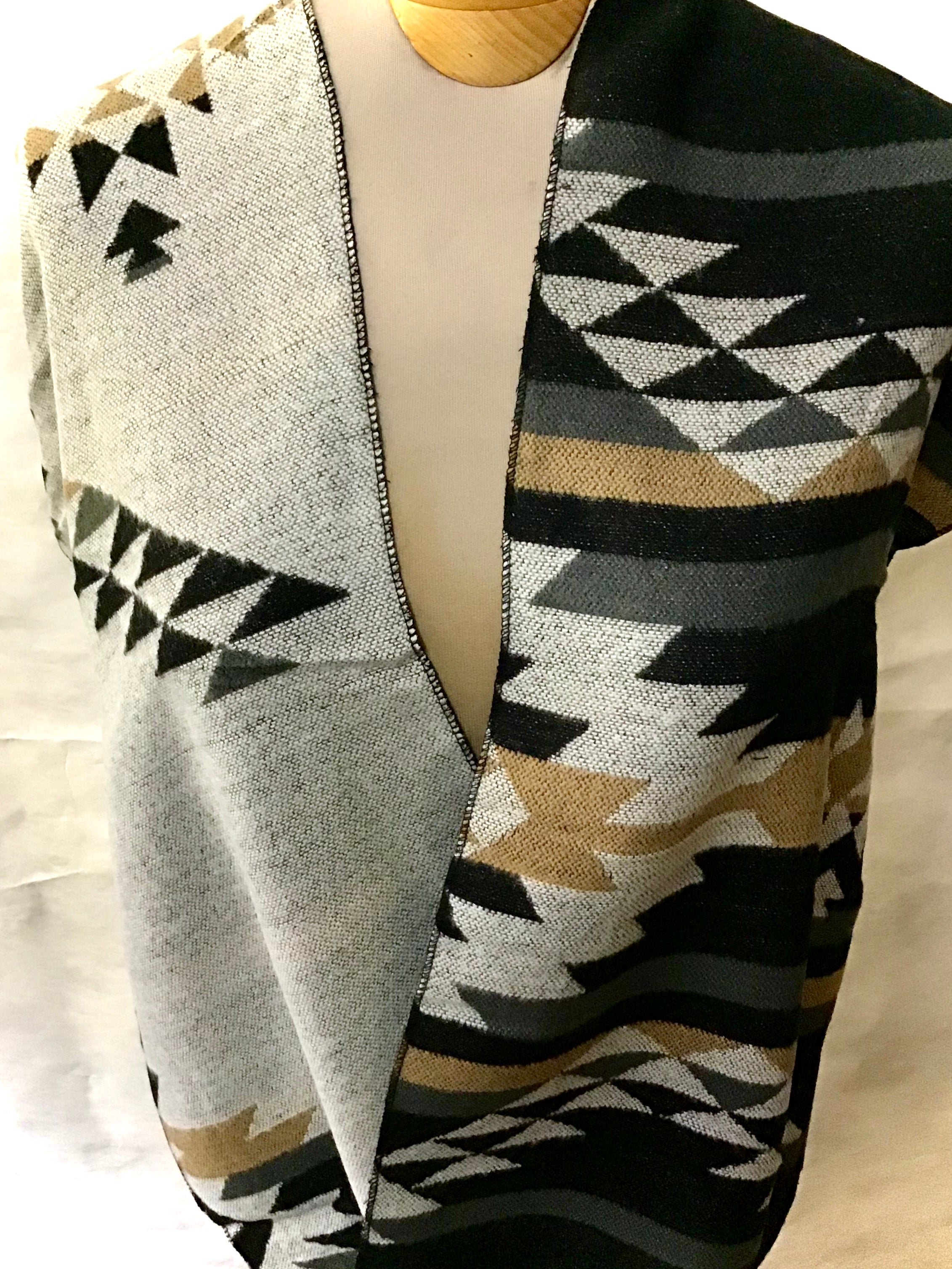 reversible Infinity scarf in greys, black, and tan.