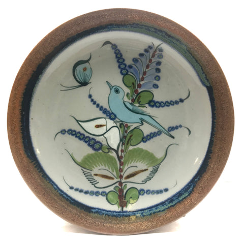 Ken Edwards Stoneware Pottery buffet plate with  green, two shades of blue and brown flowers, birds, and butterflies decorated on the side or inside on bowls or plates