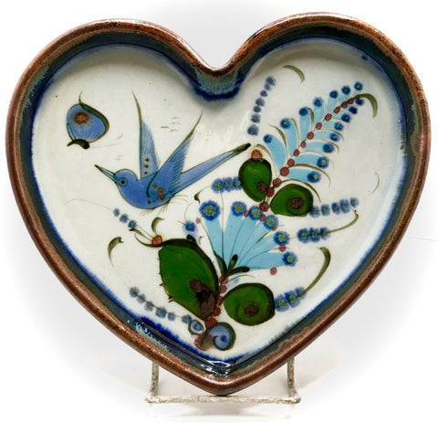 Ken Edwards Pottery tray in the shape of a heart.  Brown rim with bird and butterfly in green and blue.