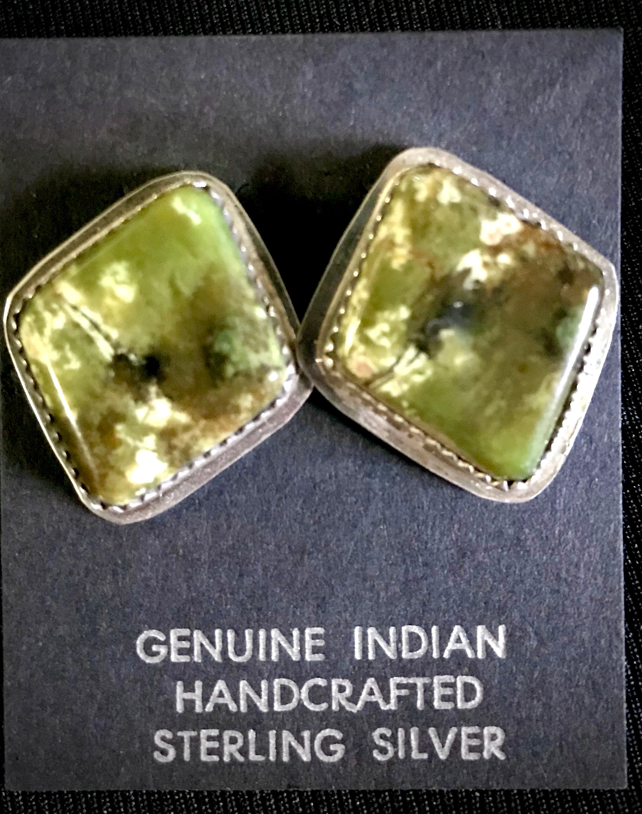 Native American Handcrafted sterling silver earrings in genuine stones.
