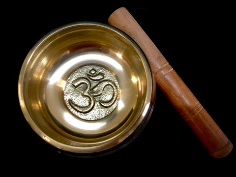Buddhist singing brass bowl with hard wood stick.