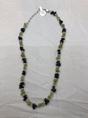 "Peridot and black onyx necklace with sterling silver beads. Adjustable length from 15 "" to 18""   USE CODE SAVE50 AT CHECKOUT TO SAVE 50%"