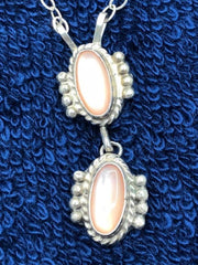 Navajo handcrafted sterling silver necklace with pink mother of pearl shell.  Use code SAVE50 at checkout to save 50%