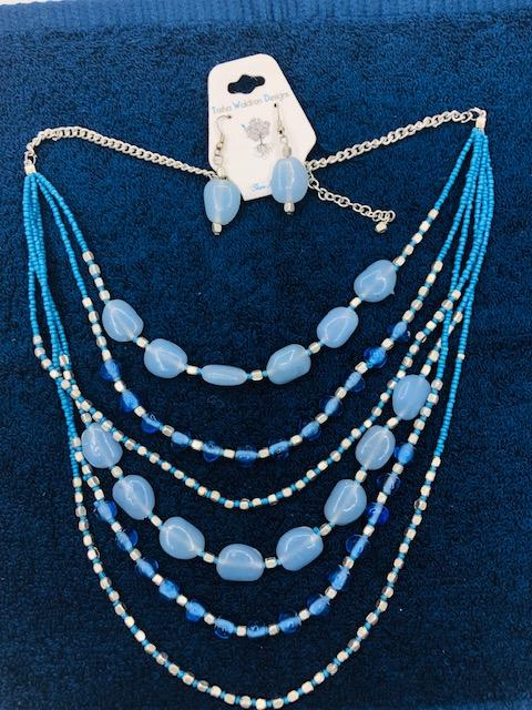 Light blue bead with turquoise color bead earring and necklace set.