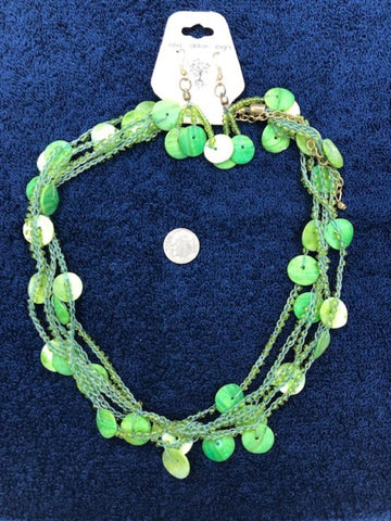 Green disc multi strand necklace with earrings