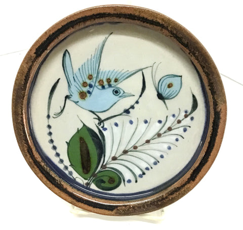 Ken Edwards round stoneware tray with green, two shades of blue and brown flowers, birds, and butterflies decorated on the side or inside on bowls or plates