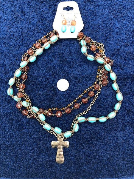 Cross necklace with simulated turquoise and earrings