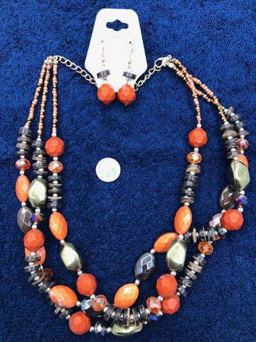Three strand necklace in orange with matching earrings