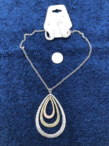 Trisha Waldron designs with chain and 3 layer oval pendant