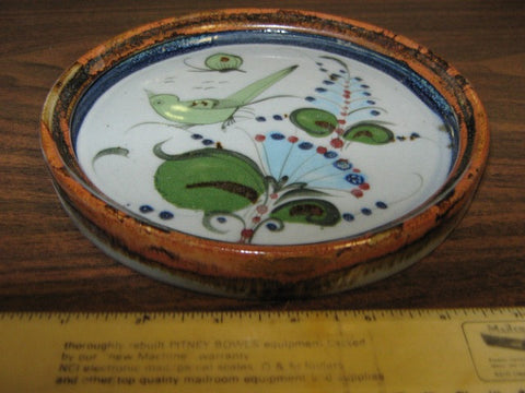 Ken Edwards Pottery small tray with brown rim and  green, blue, and black plants and birds