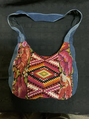"Guatemalan vintage huipil fabric made into a shoulder purse. 11"" wide by 7"" at its narrowest point. Note the strap is not full length and is for upper shoulder."