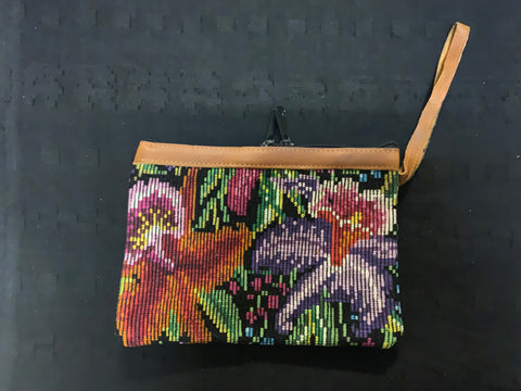 Vintage Huipil recycled into a clutch purse with leather top and handle