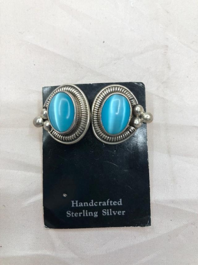 Sterling Silver Earrings with fiber optic stone.  Use code SAVE50 at checkout to save 50%