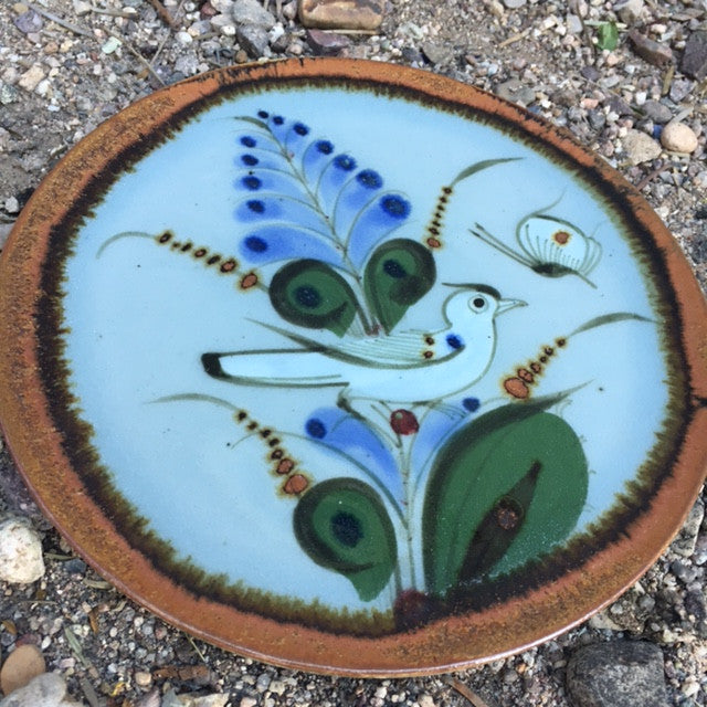 Ken Edwards Pottery round triviet with brown rim and blue and green flowers and bird.