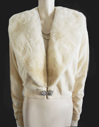 GORGEOUS VINTAGE IVORY CASHMERE EVENING SWEATER WITH AN EXTRA LARGE MINK COLLAR BY PRINGLE WITH A HUGE SPARKLING RHINESTONE CLASP MADE IN SCOTLAND