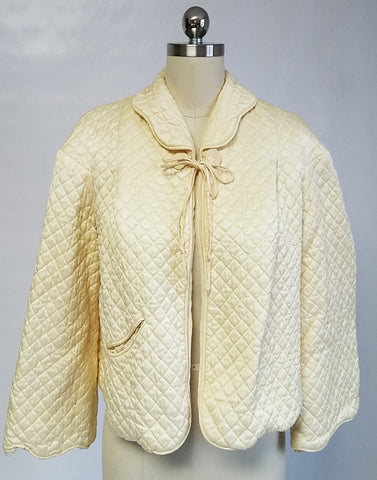 "VINTAGE BARBIZON QUILTED ""PUFFETT"" SCALLOPED BED JACKET ADORNED WITH A BEAUTIFUL COILED DECORATIVE CLOSURE IN LEMON PEEL"
