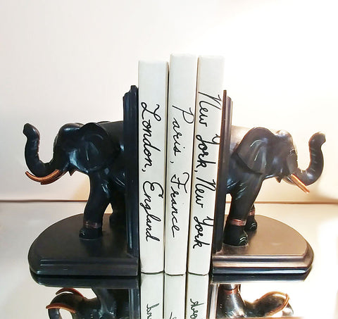 WONDERFUL BLACK & COPPER ELEPHANT BOOKENDS - VERY HEAVY AND WILL KEEP YOUR BOOKS IN PLACE