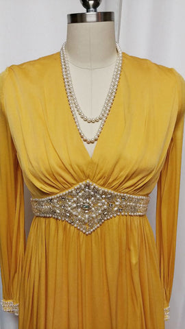 GLAMOROUS VINTAGE GRAND SWEEP EVENING GOWN ENCRUSTED WITH RHINESTONES, PEARLS, SILVER BEADS AND CRYSTALS WITH METAL ZIPPER IN PHARAOH'S GOLD