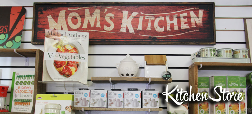 Mom's Kitchen display with cookbooks and kitchen tools