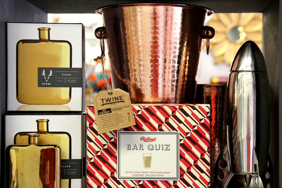 Bar quiz game on the bottom of bucket with golden flask and chrome rocket shaker