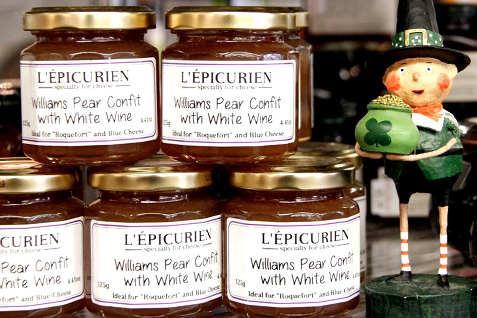 leprechaun figurine standing next to jars of Williams Pear Confit.