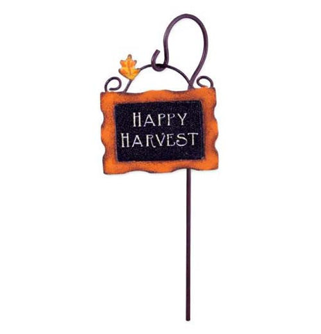"Fairy garden sign says ""Happy Harvest."" The sign is orange and black with a orange and yellow leaf."