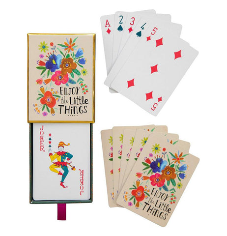 "This box of playing cards has a design of blue, brown, and red flowers against a cream background. The words, ""Enjoy the Little Things"" are shown at the bottom right in black lettering. The cards have a similar floral design as the lid of box."