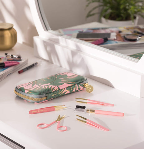 "This Eye Brow Kit ""Pink Paradise"" with tools sit on the dresser."