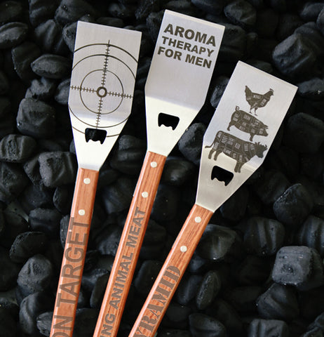 The meat pyramid spatula is shown next to two other metal spatulas.