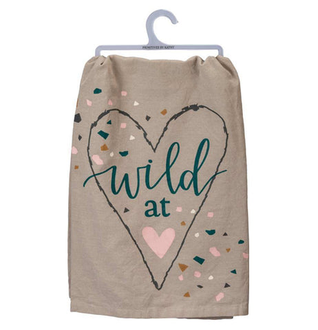 "This gray dish towel has a picture of a heart with the words, ""Wild at"" in green lettering. A pink heart symbol sits below the words."