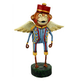 Flying monkey has a blue and gold outfit on with a red hat.