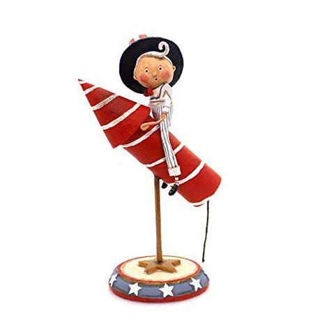 This figurine is dressed in a white Uncle Sam outfit with a red, white, and blue hat and sits on a red and white striped rocket which is mounted on a star spangled stand.
