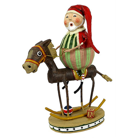 This sculpted figurine is of Santa Claus in green and red clothing with his red hat riding on a sculpted toy donkey. Next to the donkey sits a letter block and between its legs sits a red, white, and black ball.