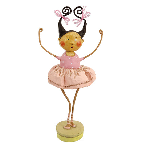 This human figurine is of a girl with black hair in pigtails wearing a pink ballet tutu.