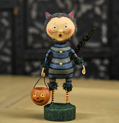 The Sour Puss figure sits on the wooden table.