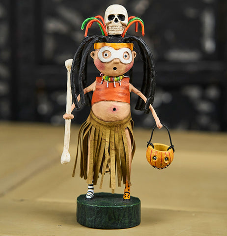 The Witch Doctor figure on the wooden table.