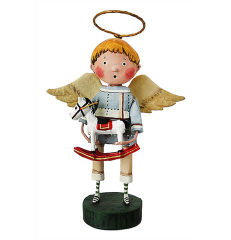 This sculpted figurine is of a Christmas angel with blonde hair, white wings, a golden halo, and wearing a blue grey shirt, tan pants, and black shoes with black and white socks. In both hands, he holds a sculpted toy figurine of a horse.