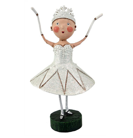 This snow queen is with her tiara and a white dress and holding her hands up.