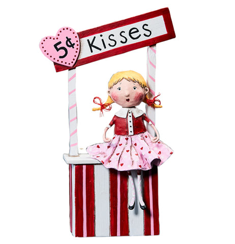 "The 5 Cent Kisses shows the figurine of a girl wearing a pink skirt sitting on a kissing booth. A sign saying, ""5 cent kisses"" in black lettering is shown with the ""5 cent"" imprinted on a pink heart shaped sign."