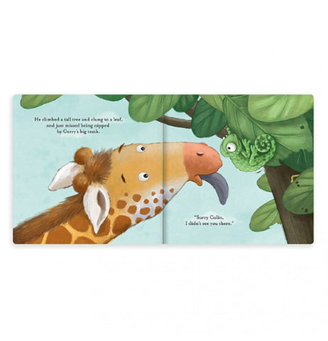 Two pages of the book are open showing a giraffe licking leaves out of one part of a tree. A green chameleon is seen in another part of the tree on the page to the right hand side.